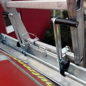 Close-up view of mounted LeiKoSi ladder head safety system on gutter.